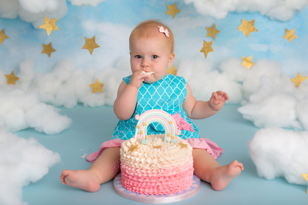 Nicole Israel Photography Gold Stars Blue Sky Clouds Cake Smash Pink Blue